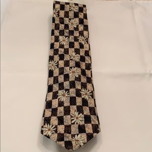 Hugo boss tie. Brown with tan and flower pattern
